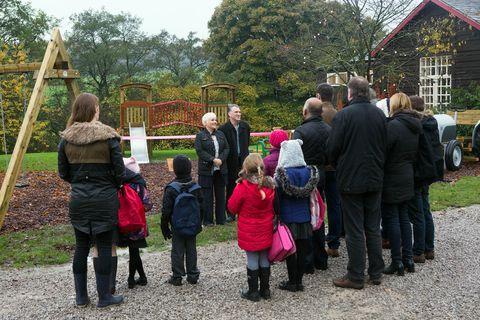 Mammal, Public space, Pole, Boot, Garden, Cottage, Park, Playground, Outdoor play equipment,