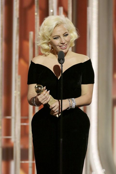 Lady Gaga accepts the award for Best Actress in a Limited Series or TV Movie during the 73rd Annual Golden Globe Awards