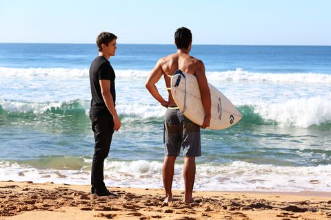 Kyle finds Andy on the beach looking sombre after a surf