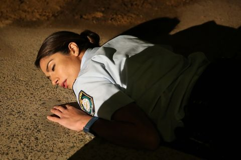 A shadow falls over Kat as she passes out 