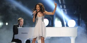 Jade Ewen and Andrew Lloyd Webber perform during the Eurovision 2009