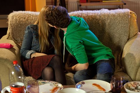  Tom shows Peri pictures and videos of their baby and they kiss.