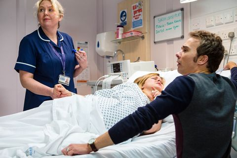 David supports Sarah when she goes into labour