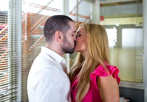 Aidan and Eva kiss