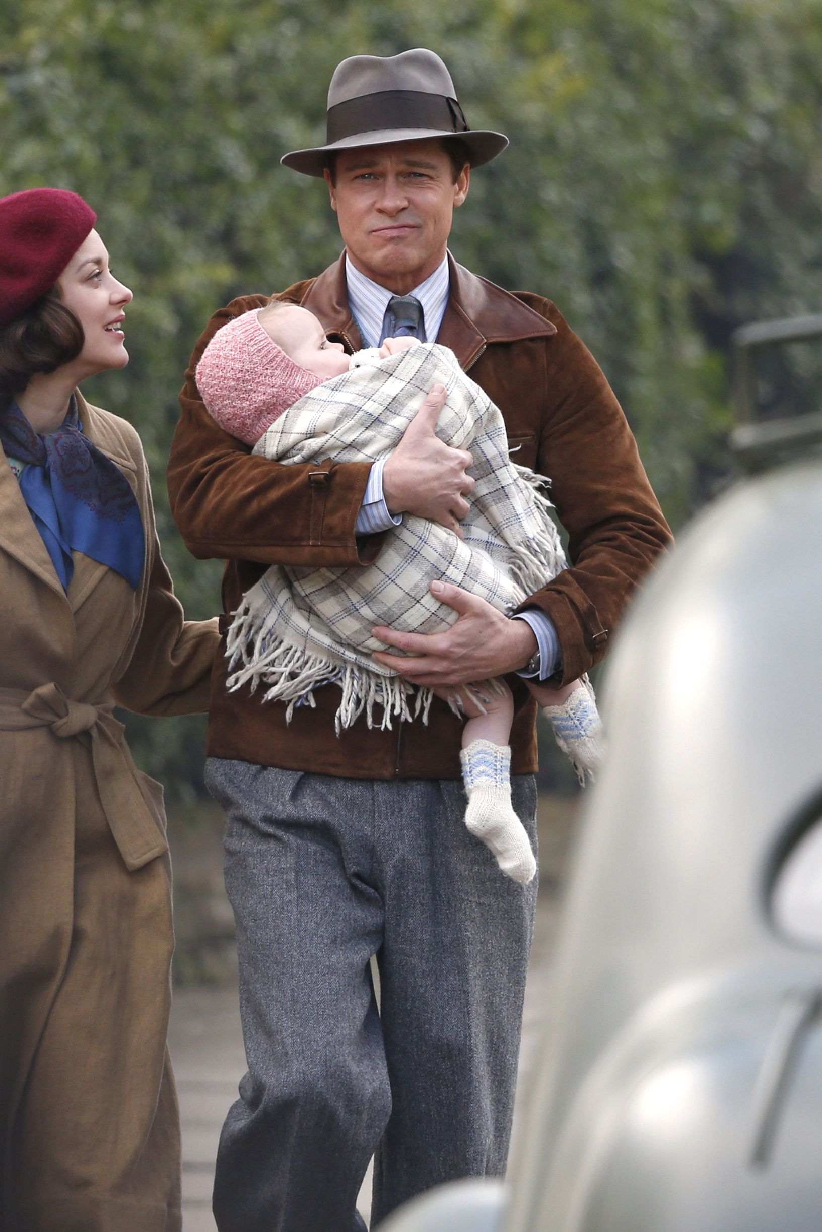 Brad Pitt Plays A Doting Parent With Marion Cotillard On Set In