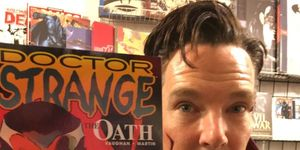 Benedict Cumberbatch poses with a Doctor Strange comic