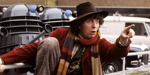 Doctor Who's Tom Baker with some Daleks