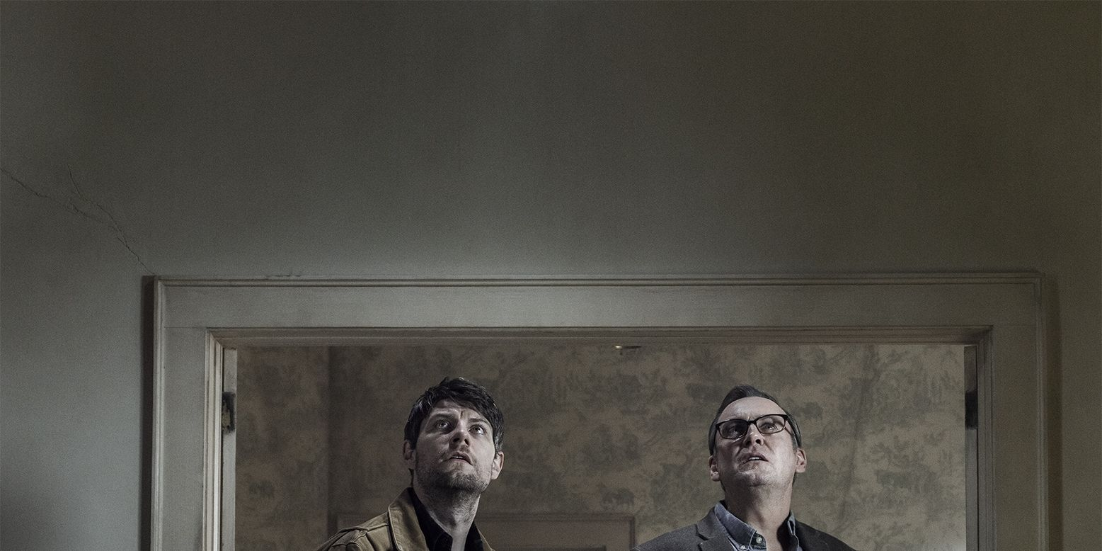Patrick Fugit, as Kyle Barnes, Philip Glenister as Reverend Anderson in Outcast