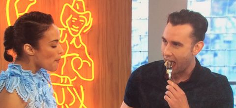 Matthew Lewis eating pizza on Sunday Brunch