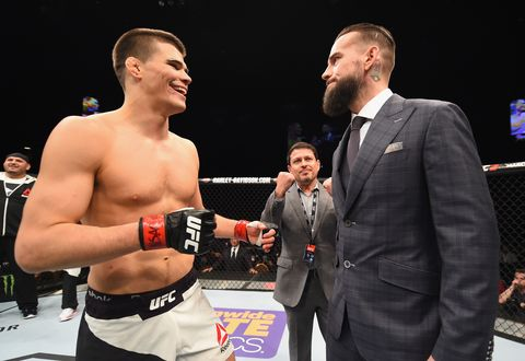 Phil 'CM Punk' Brooks faces off with Mickey Gall after Gall's victory over Mike Jackson during the UFC Fight Night event at MGM Grand Garden Arena on February 6, 2016 in Las Vegas, Nevada.