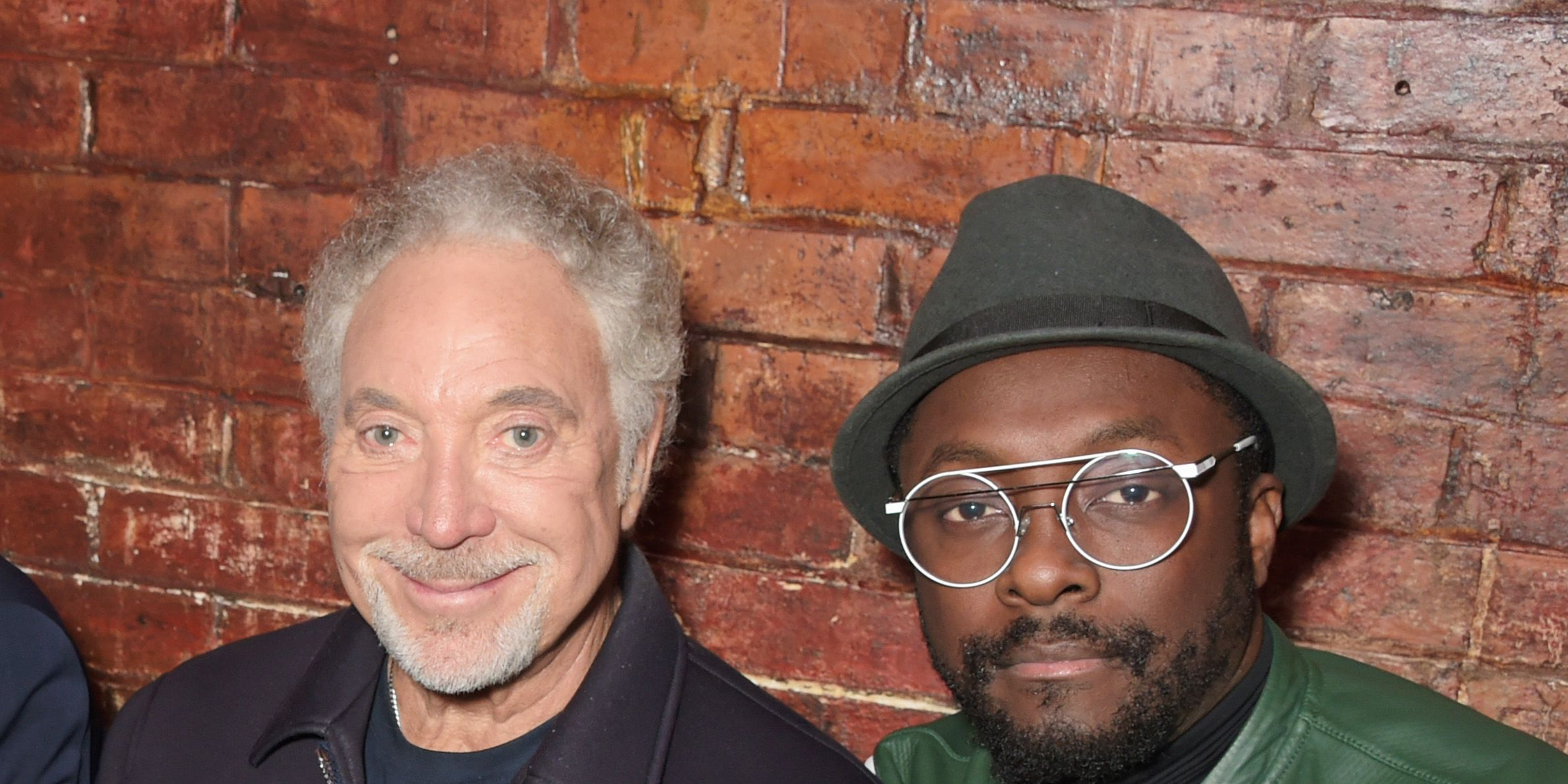 Coaches Sir Tom Jones (L) and will.i.am attend 'The Voice' secret gig ahead