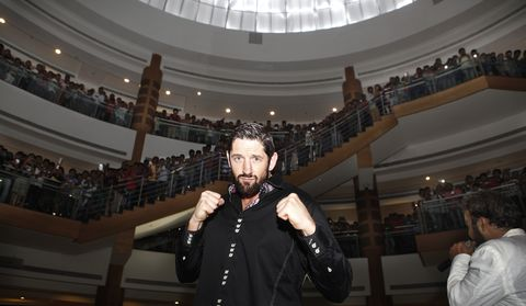 WWE Star Wade Barrett oses with his fans during an promotional event at Inorbit Mall, Malad on September 18, 2014 in Mumbai, India.