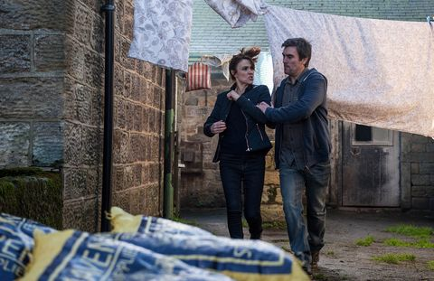 Cain Dingle drags Emma Barton out of Butler's Farm in Emmerdale
