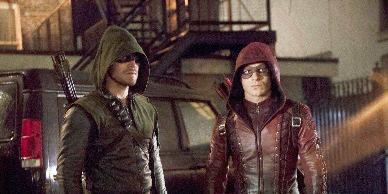 Stephen Amell as Oliver Queen / The Arrow and Colton Haynes as Roy Harper / Arsenal in Arrow S03E13: 'Canaries'