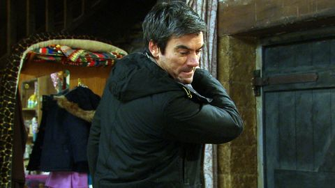 Cain Dingle raises his fist to Kyle in Emmerdale