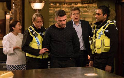 EMBARGO 10/1 Aaron is taken away by the police in Emmerdale