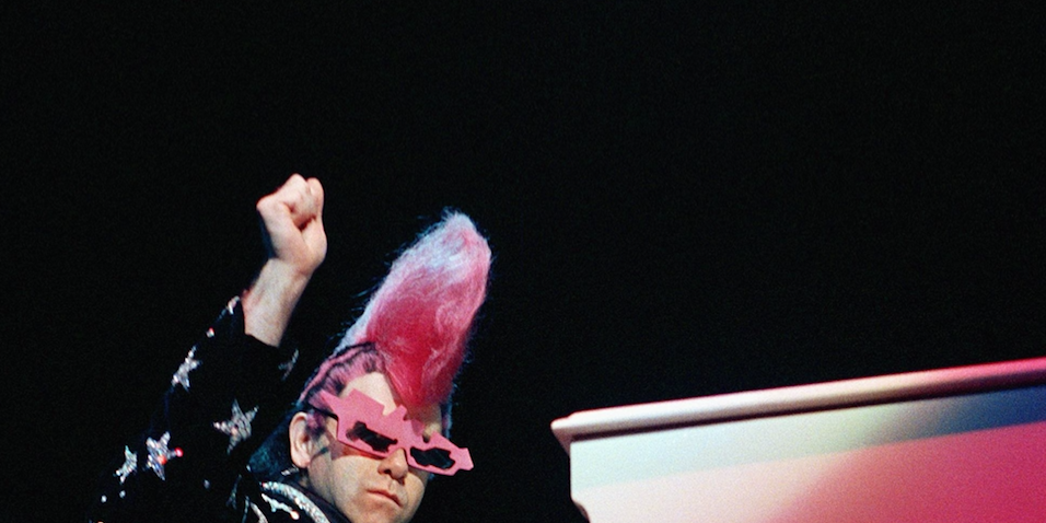 Elton John performs at the piano during an appearance