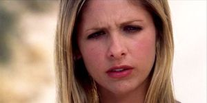 Sarah Michelle Gellar as Buffy the Vampire Slayer frowning in Restless
