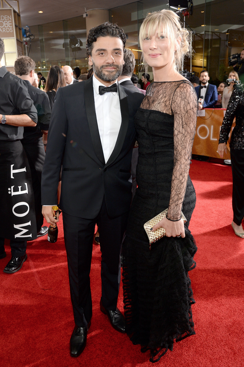 Oscar Isaac (L) and Elvira Lind attend the 73rd Annual Golden Globe Awards