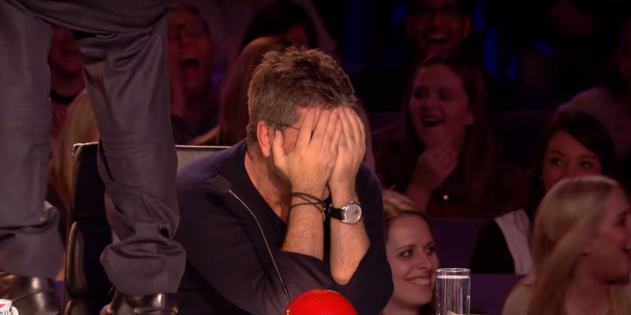 Simon Cowell with his face in his hands on Britain's Got Talent