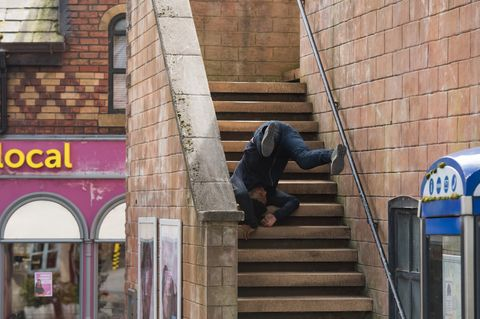 Zack Loveday falls down the City Steps in Hollyoaks