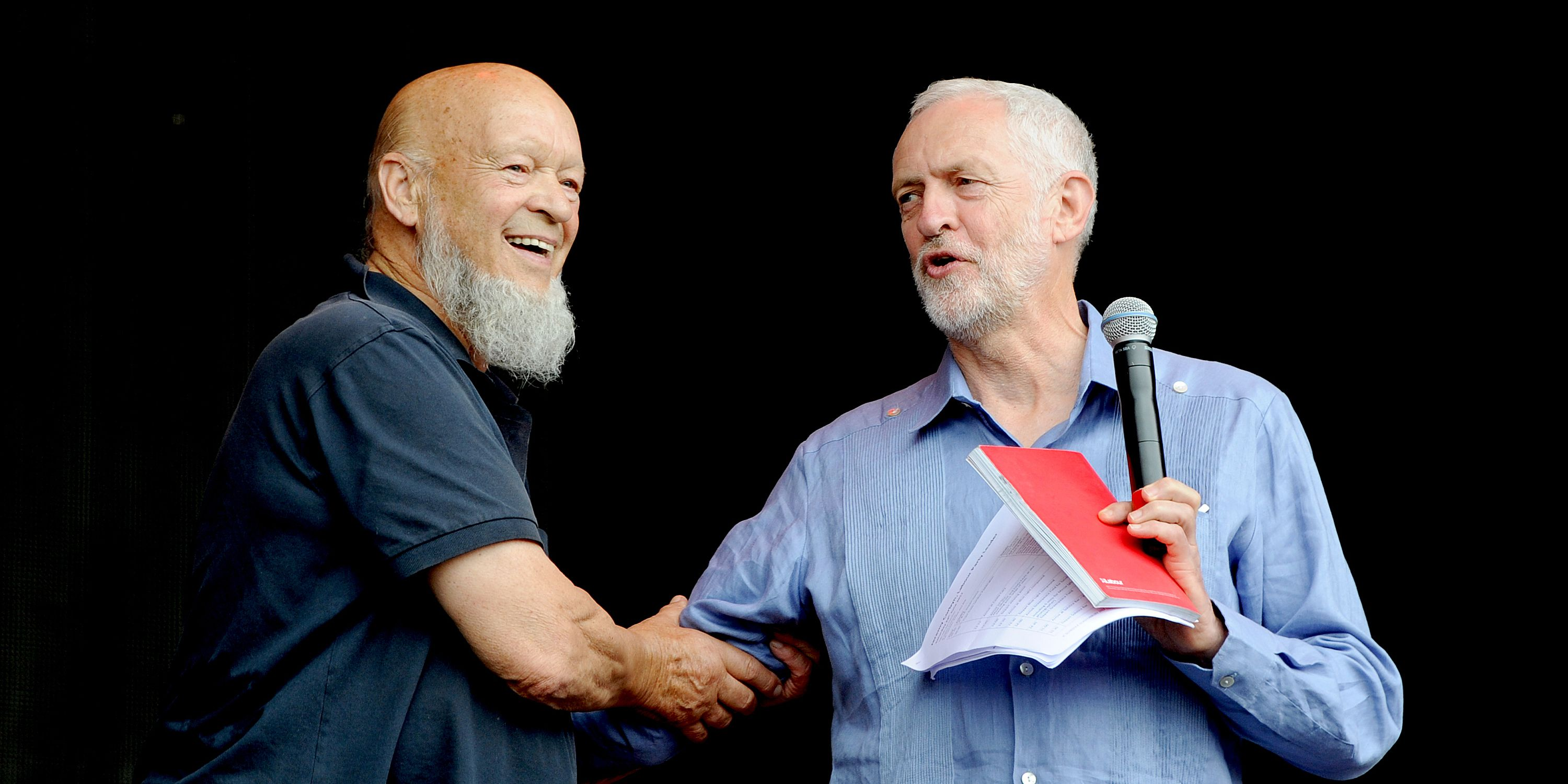 Jeremy Corbyn is introduced by Michael Eavis on the Pyramid stage on day 3 of the Glastonbury Festival 2017