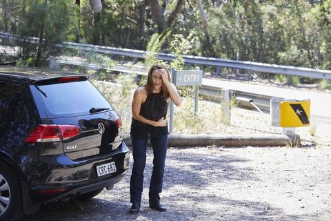 Roo Stewart is in pain at the side of the road in Home and Away