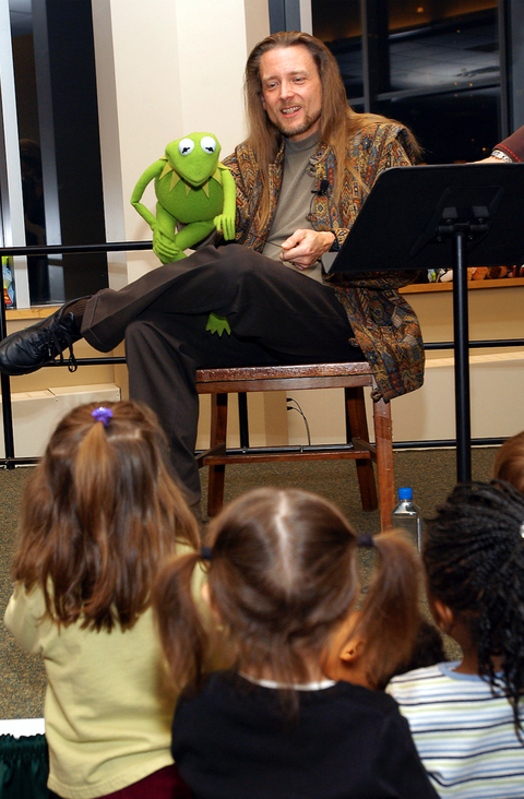 Muppet Kermit the Frog and his operator Steve Whitmire lead a sing-a-long at Barnes & Noble
