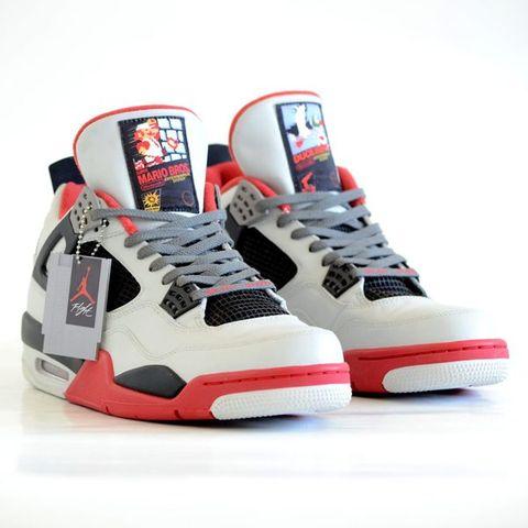 54b79f36e4 These custom Nintendo Nike Air Jordan IV trainers are a super ...
