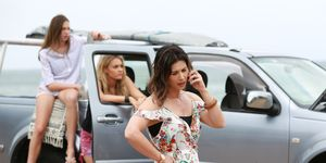 Maggie Astoni makes a phone call while Coco and Ziggy sit in the car bored in Home and Away