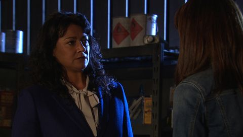 Emma Barton and Moira Dingle have a showdown in a burning barn in Emmerdale