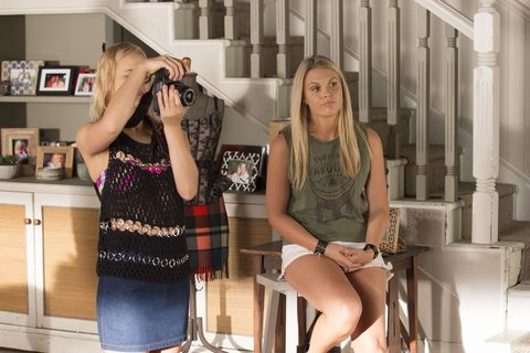 Olivia Fraser Richards takes photos of her designs in Home and Away