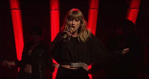 Taylor Swift Performs On Saturday Night Live With A Snake Wrapped Microphone