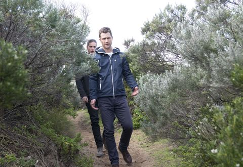Mark and Tyler Brennan search the bushland for clues in Neighbours