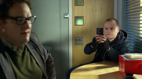 Kyle Hughes takes a photo of Al Haskey in Doctors
