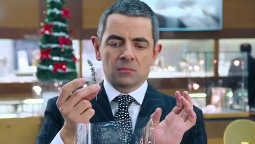 Love Actually FACTBOMB: Did you know WHY Rowan Atkinson took so long to wrap that gift?