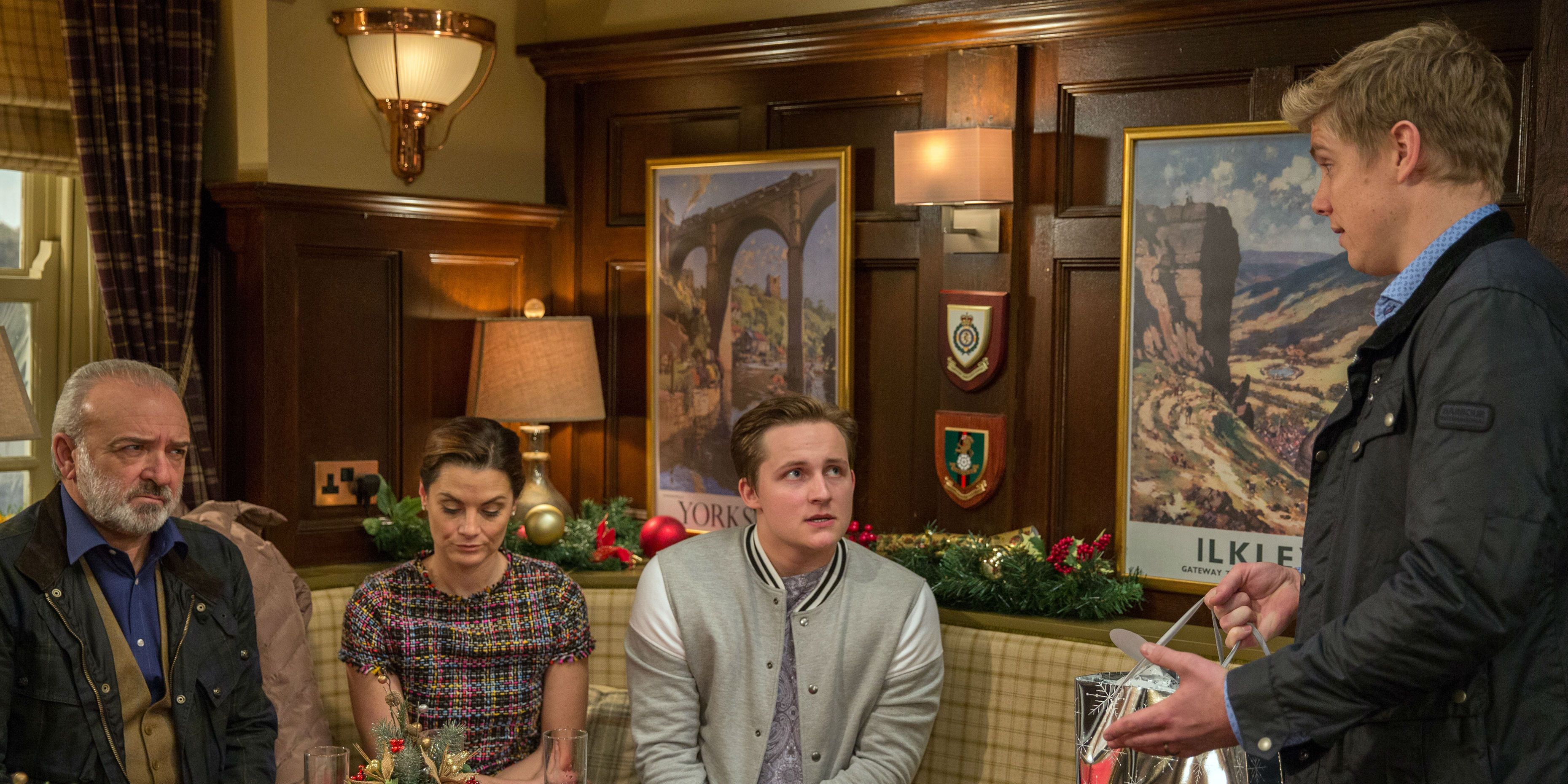 Robert Sugden receives a frosty reception from Lawrence, Chrissie and Lachlan White in Emmerdale