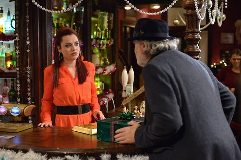 Whitney Carter reacts as Aidan Maguire delivers a present for Mick in EastEnders