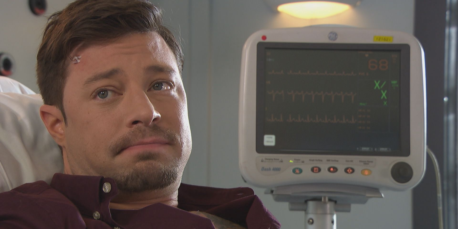 Tegan Lomax hooks Ryan Knight up to a lie detector test, with Ste Hay watching on, in Hollyoaks
