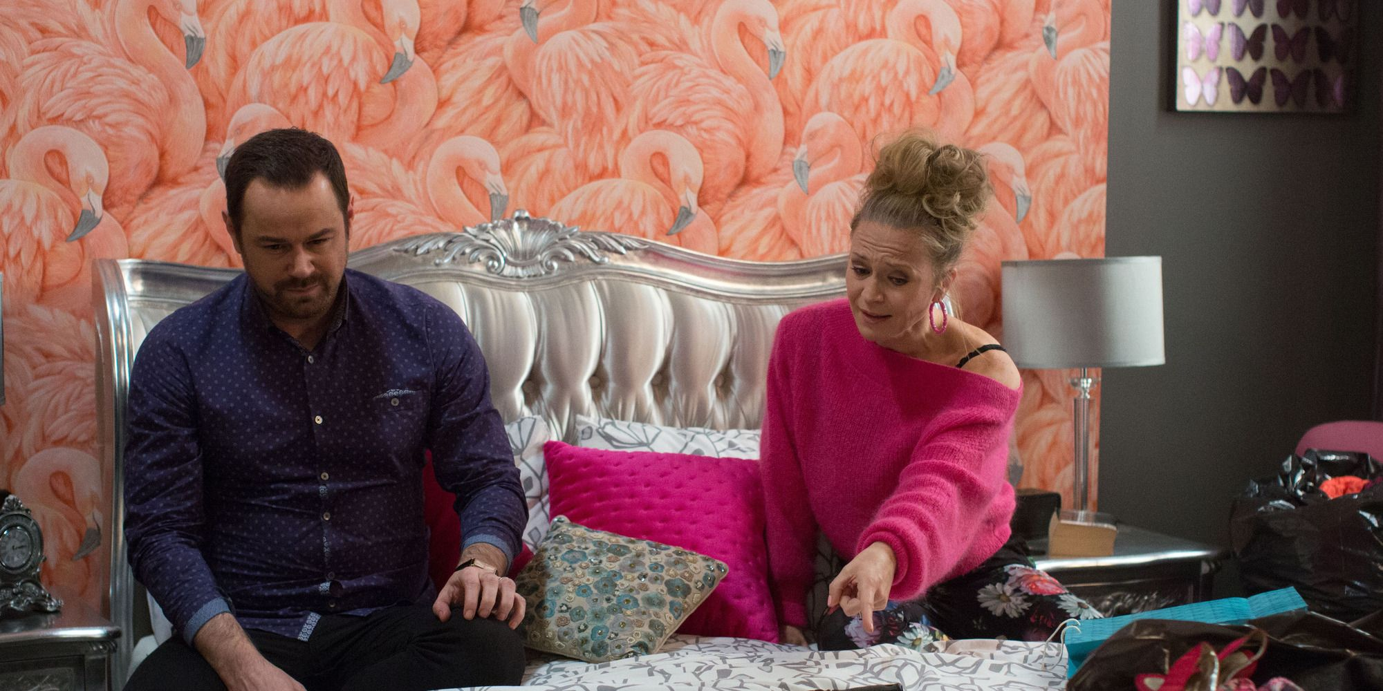 Mick and Linda Carter argue over the gun in EastEnders