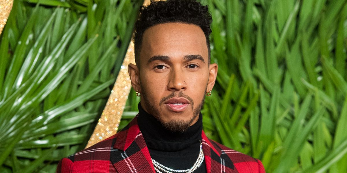 Lewis Hamilton ditches short hair for a curly transformation