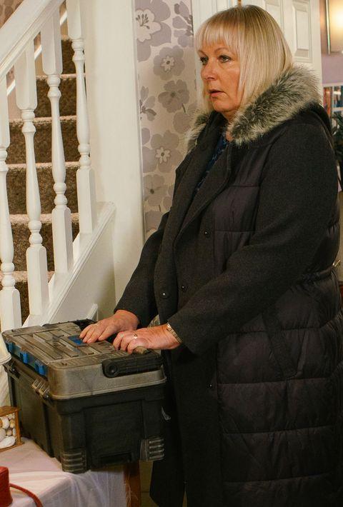 Eileen Grimshaw checks Pat Phelan's toolbox in Coronation Street