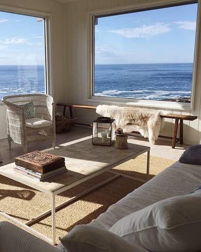 Room, Interior design, Table, Furniture, Ocean, Floor, Living room, Flooring, Daylighting, Coffee table,