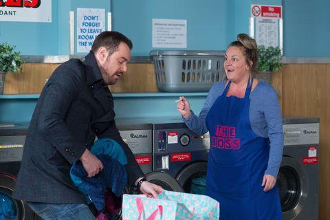 Mick Carter brings ironing to Karen Taylor in EastEnders