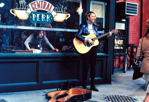 Phoebe with her guitar outside Central Perk, Friends