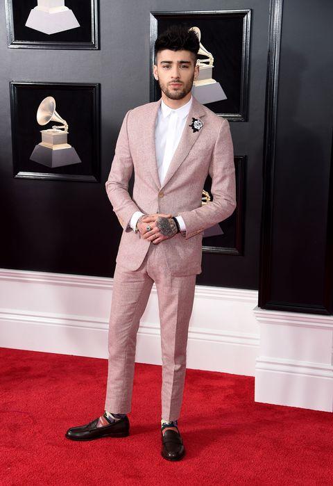 Red carpet, Suit, Carpet, Clothing, Formal wear, Fashion, Flooring, Tuxedo, Outerwear, Blazer,
