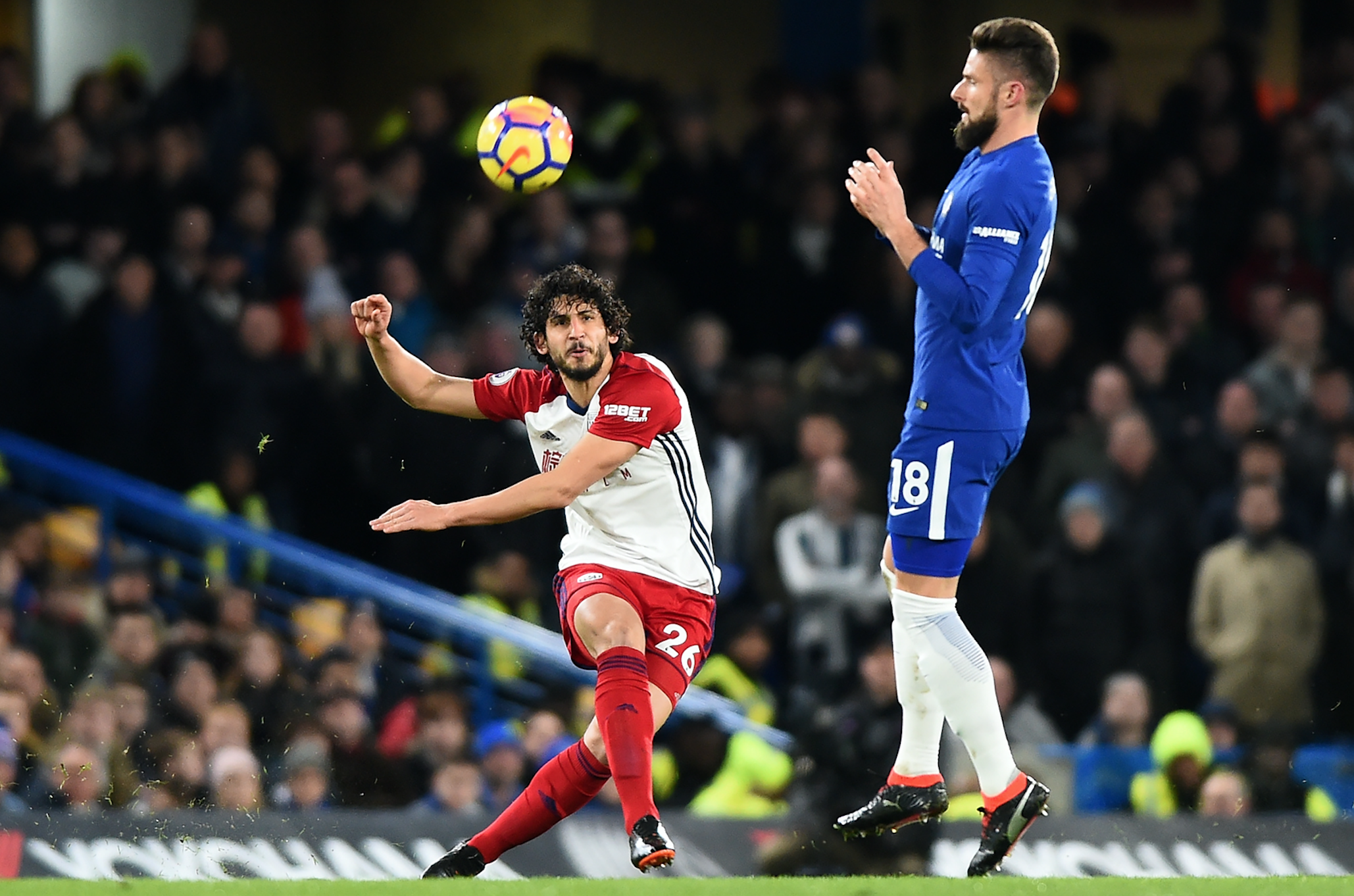 West Bromwich Albion's Ahmed Hegazi clears over Chelsea's Olivier Giroud during the Premier League match between Chelsea and West Bromwich Albion (WBA) at Stamford Bridge, London, England on 12 Jan 2018