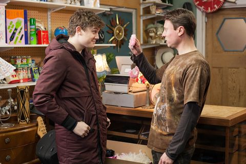 Tom Cunningham buys handcuffs from Milo Entwistle in Hollyoaks