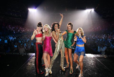 Melanie Chisholm, Emma Bunton, Melanie Brown, Victoria Beckham and Geri Halliwell of the Spice Girls perform on stage