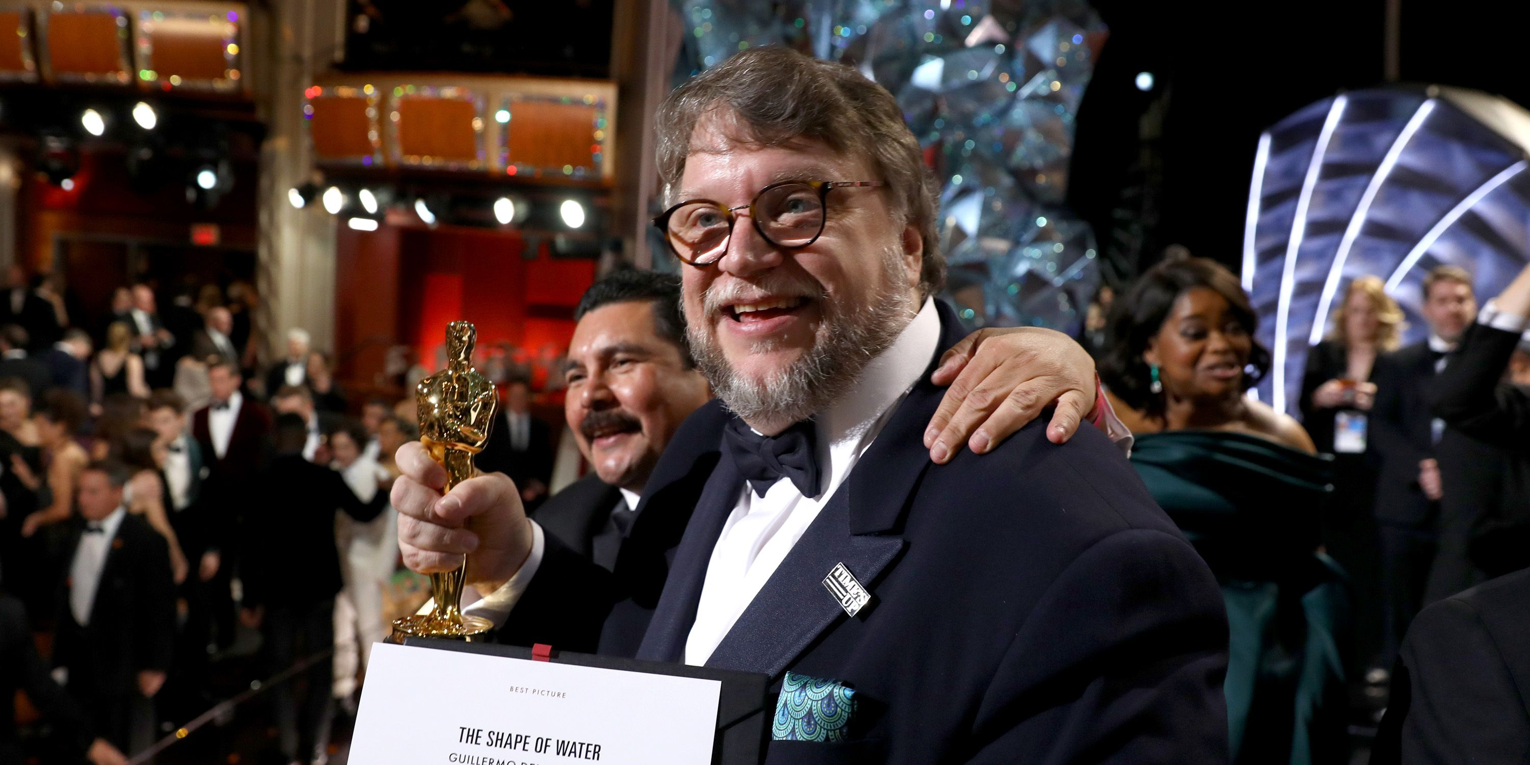 Guillermo del Toro with his Oscar and winner's card for The Shape of Water